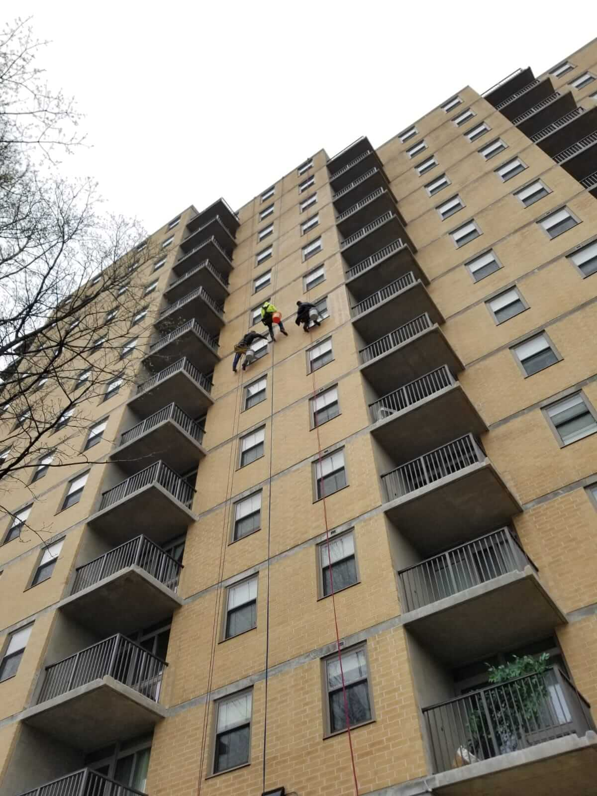 Presto waterproofing technicians rappelling off of B'nai B'rith Apartments, Allentown, PA
