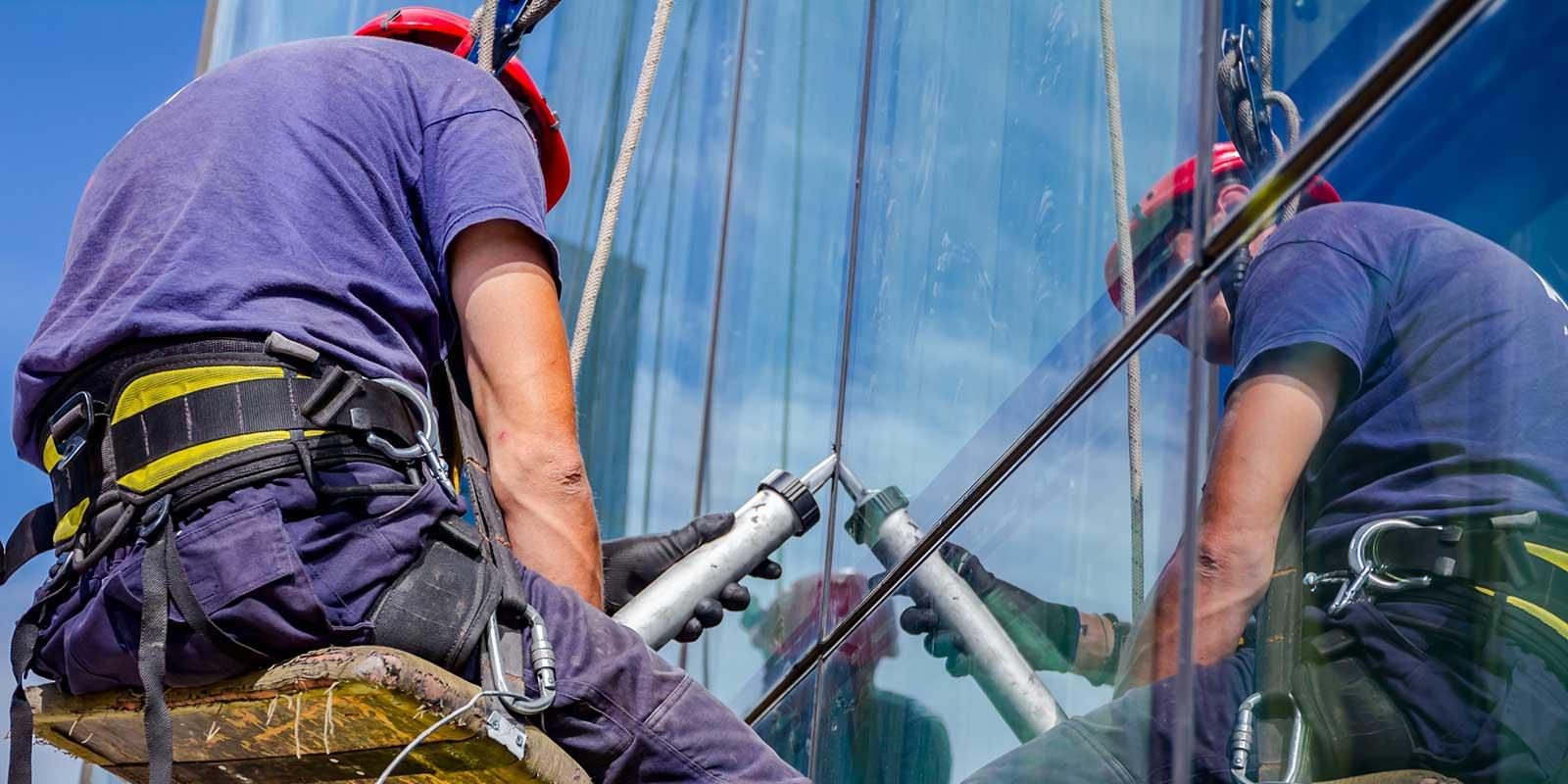 Caulking specialist applying caulking to window frame