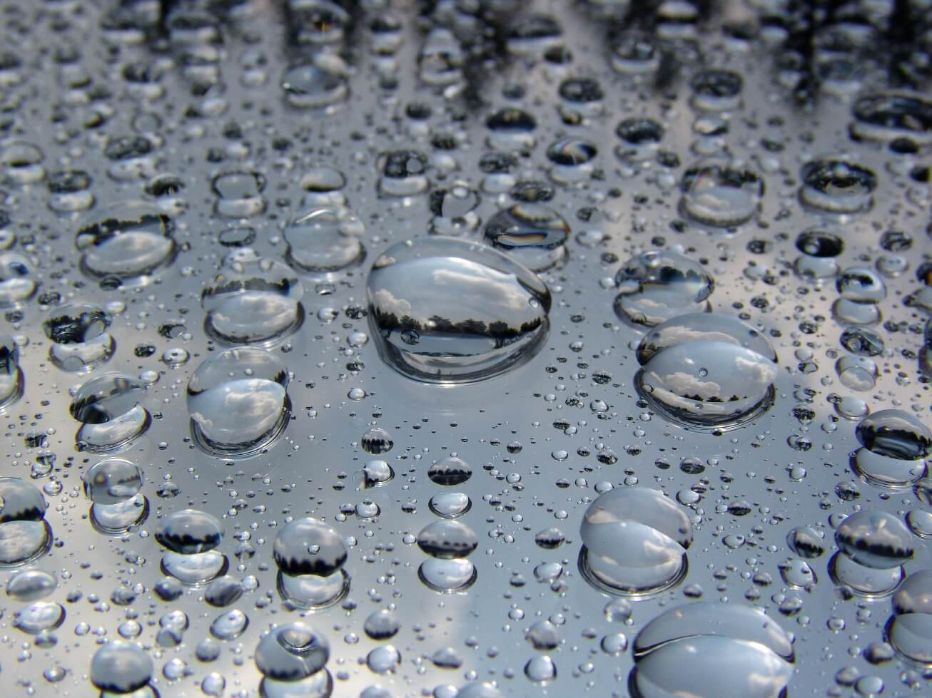 Water droplets beading on window glass after protective coating applied - Presto Restoration Products, LeachStop