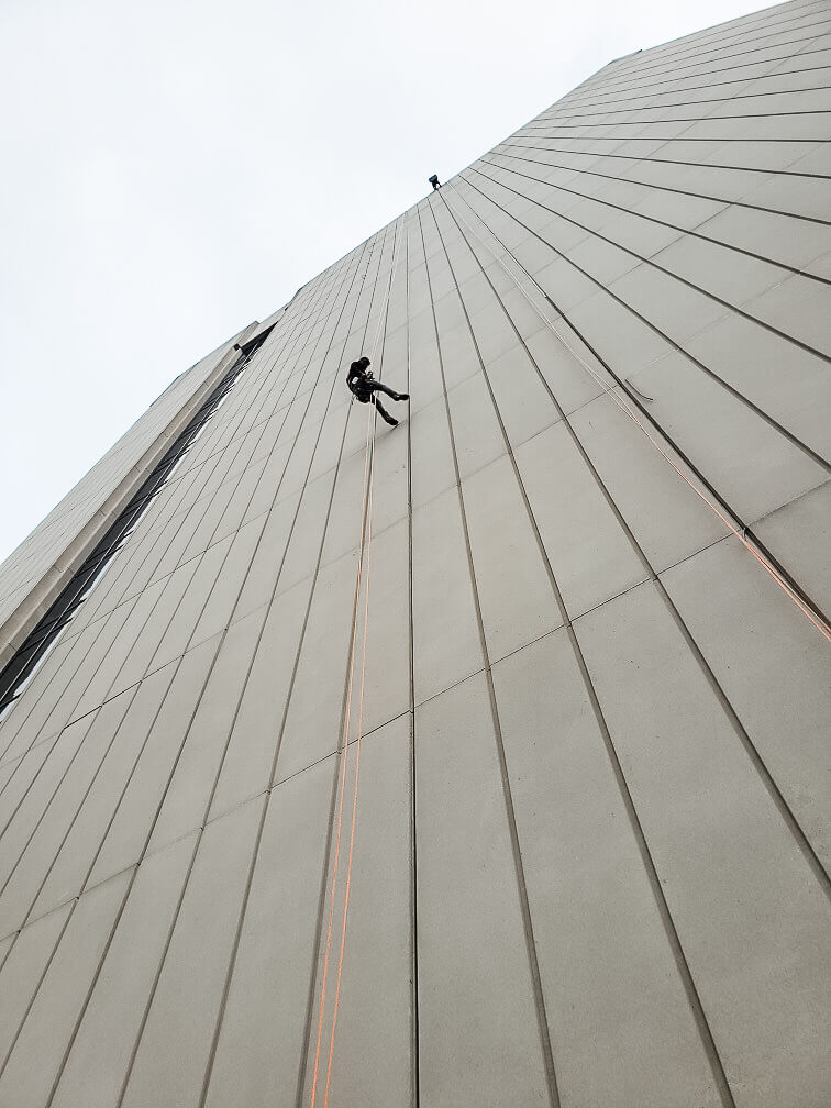 Presto waterproofing technicians rappelling off Reynolds American high-rise building in Winston-Salem, NC