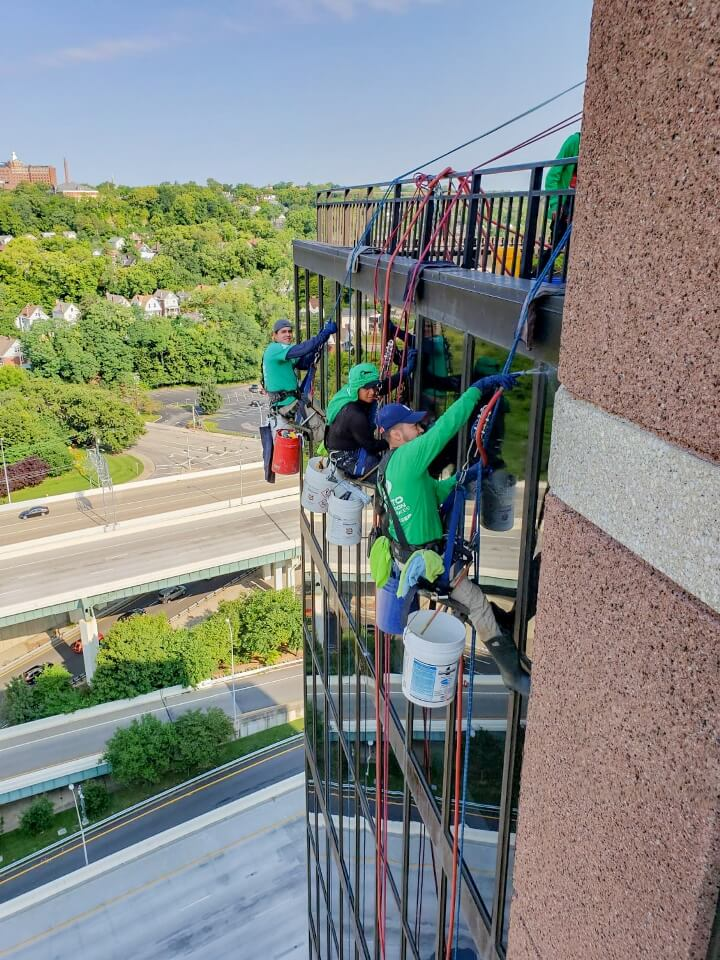 Presto technicians hanging on ropes performing surface restoration and waterproofing services on Cincinnati office building