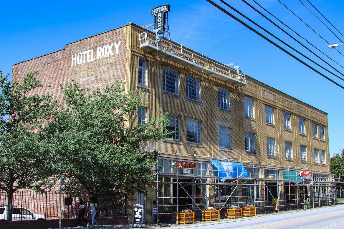Swing stage on historic loft building in Atlanta for performing restoration and waterproofing on the facade
