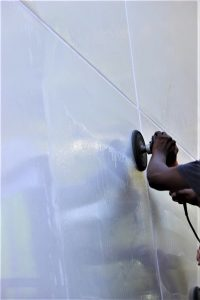 Presto technician restores alucobond panel