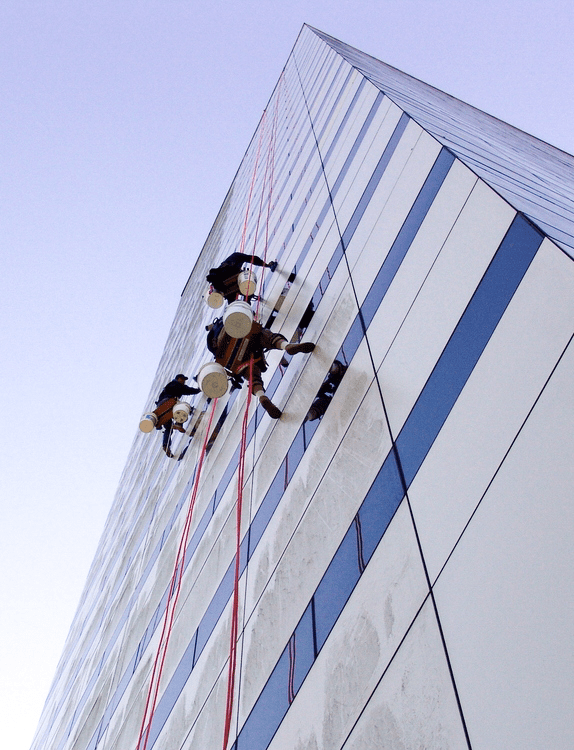 Technicians rappelling from the roof of The Ralph D. Turlington Florida Education Center in Tallahassee, FL