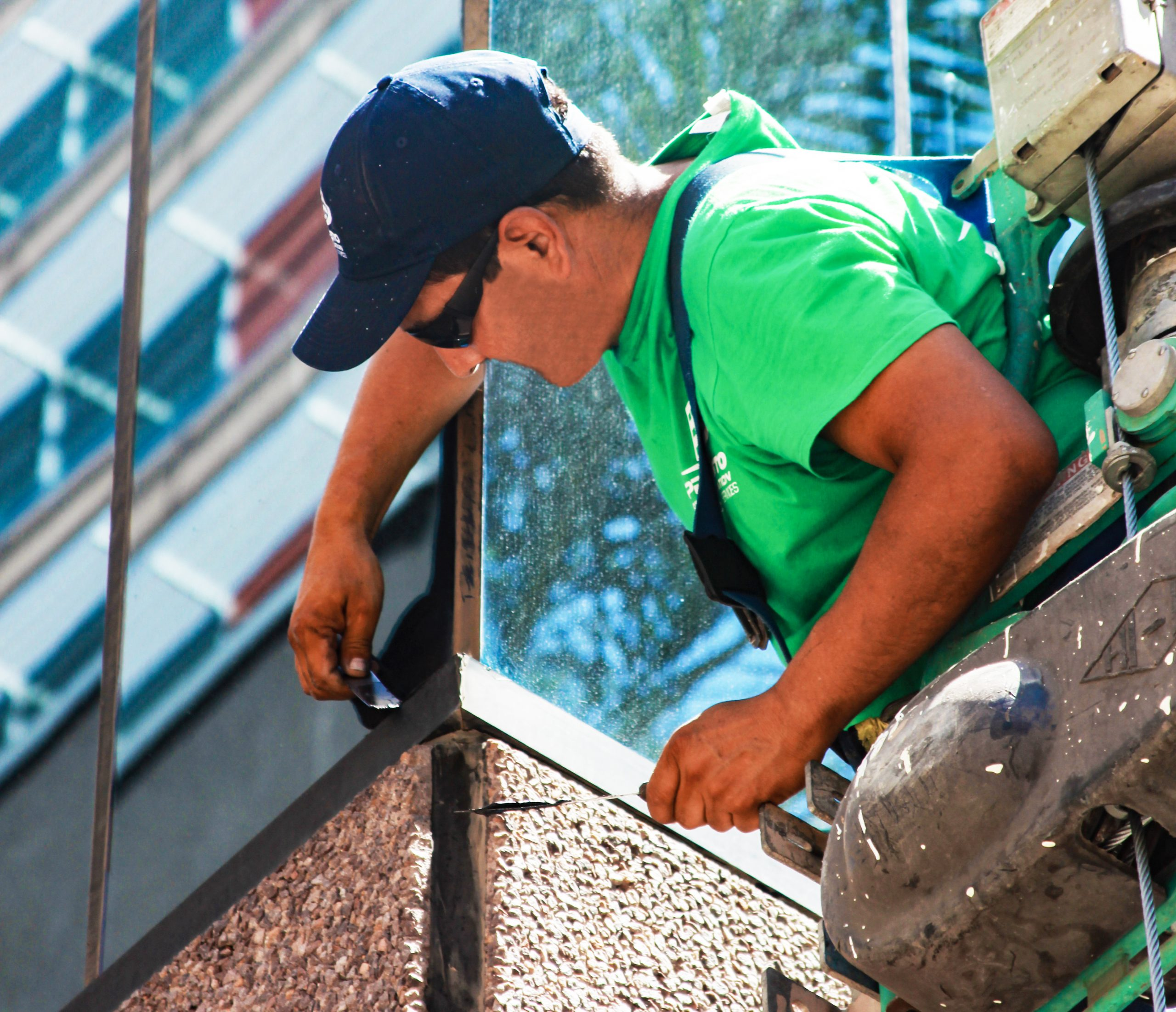 Presto Restoration technicians use swing stages to waterproof all area building's facade in Phoenix, AZ
