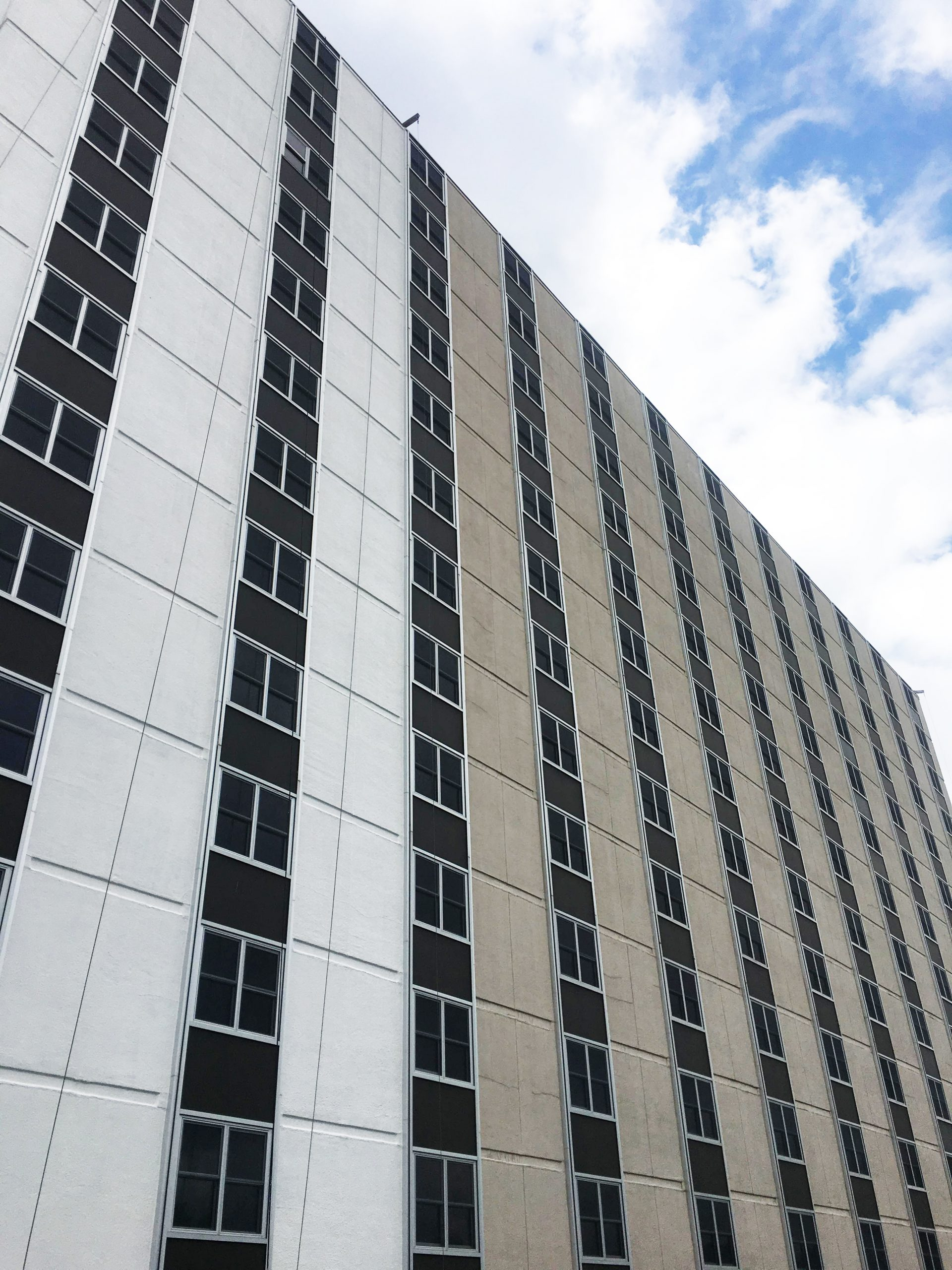 Bromley Hall student residential building in Champaign, IL undergoing Presto surface restoration and repairs to cracks and voids in the EIFS system