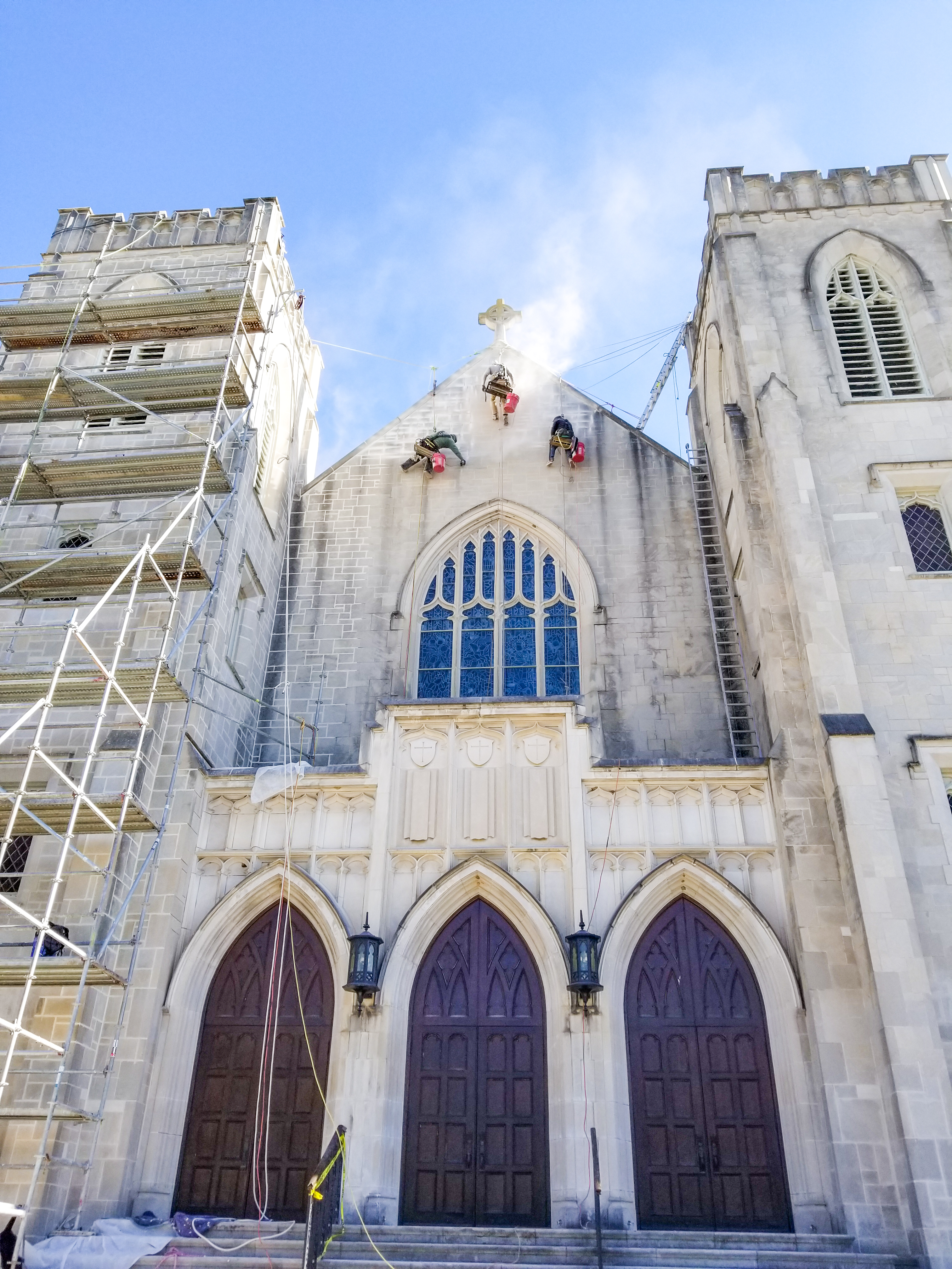 Presto technicians rappel from structure to restore stone surface of historic Mulberry Street United Methodist Church in Macon, Georgia