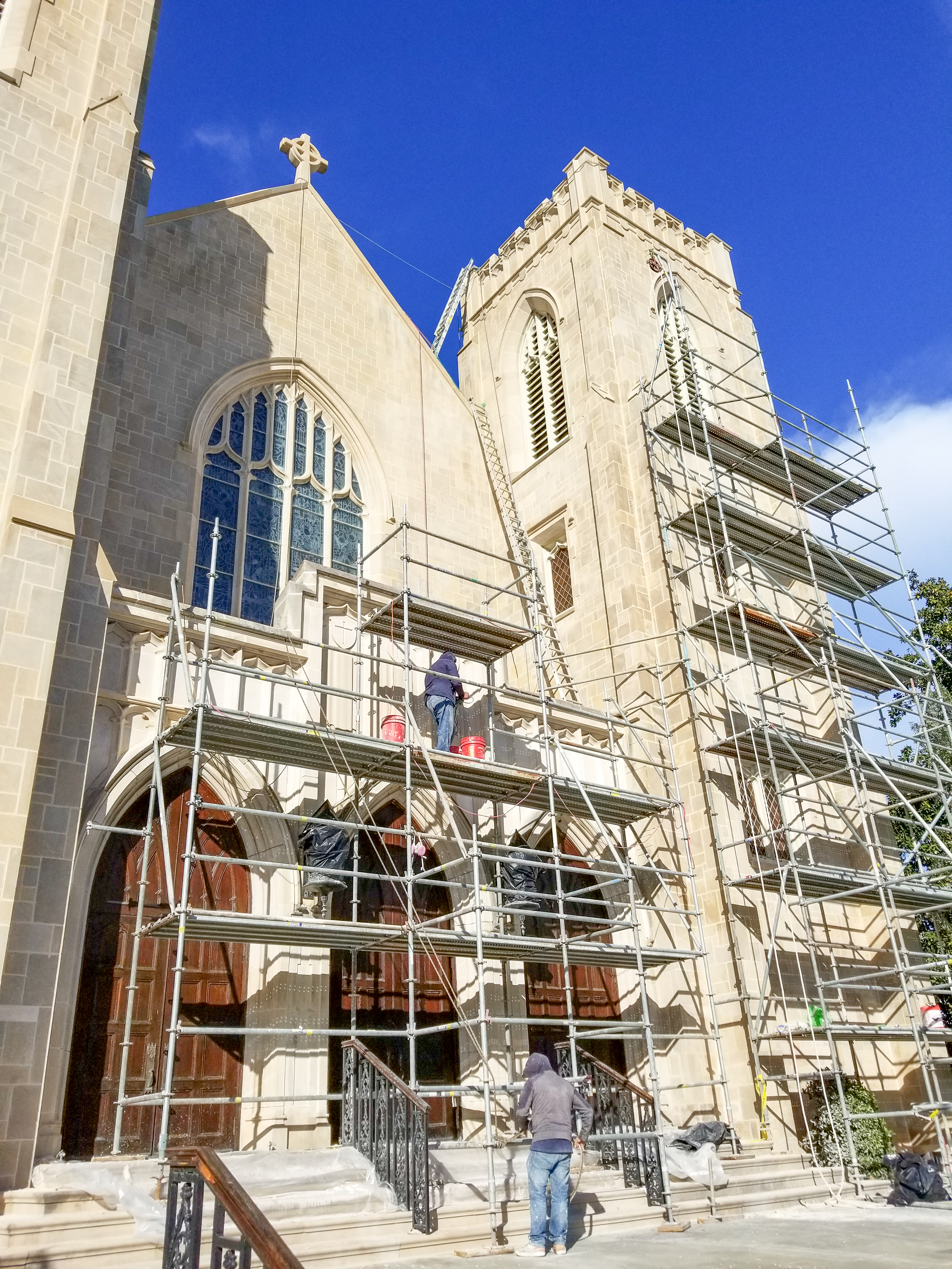 Presto technicians on scaffoldings to perform exterior historic preservation and waterproofing services on Gothic-style church in Macon, Georgia