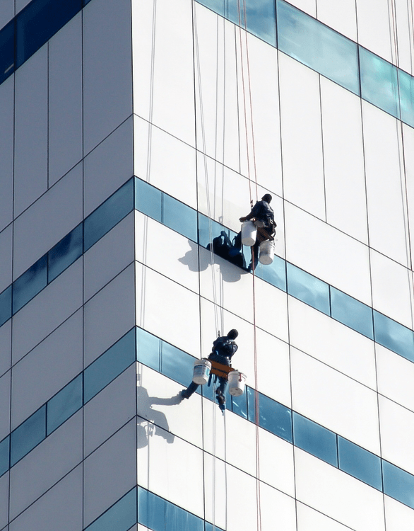 Presto technicians perform metal and glass restoration on facade of the Turlington Building in Tallahassee, FL
