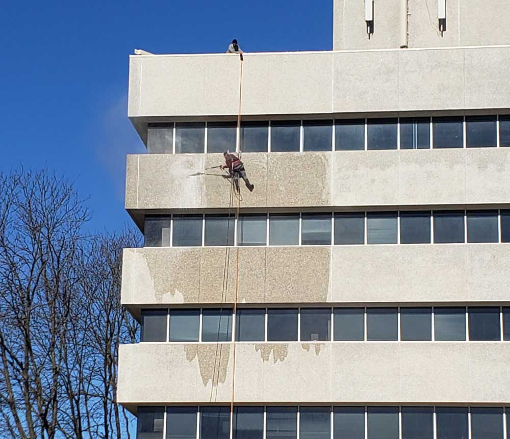 Presto crew using rappelling equipment for office building restoration