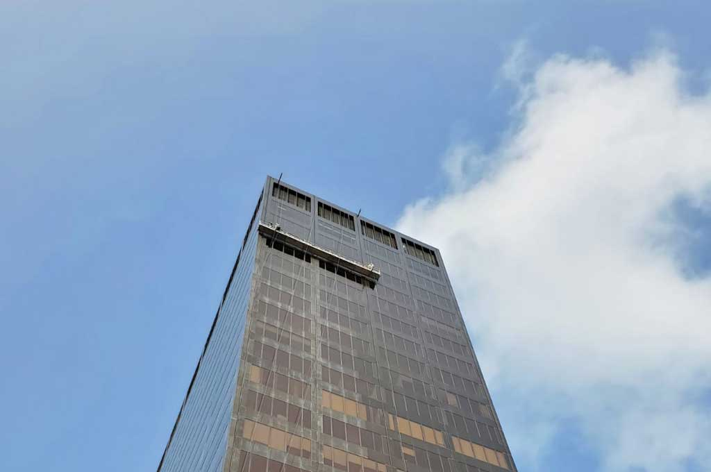 Stratacache glass and metal restoration in dayton ohio building and clouds