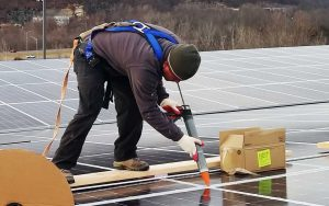 Presto commercial building caulking services waterproofing solar panels