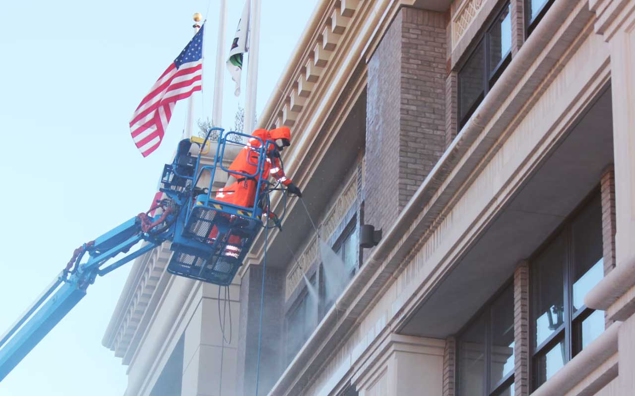Commercial Building Restoration Contractors Cleaning a Building in California