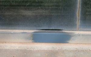 Test area of metal window frame restoration services