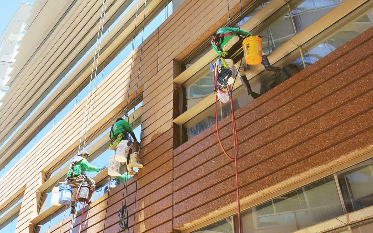 commercial building waterproofing contractors applying coating