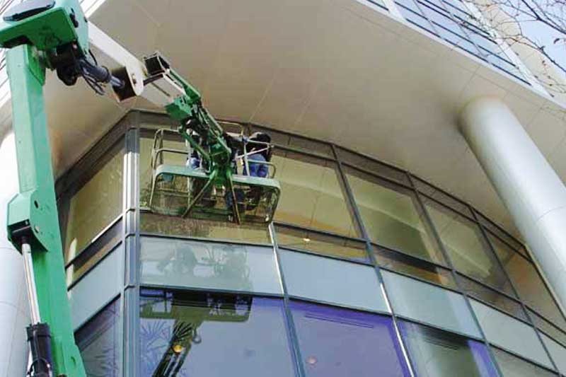 Using boom lifts to clean and seal all the exterior surfaces of the CDC building in Morgantown West Virginia