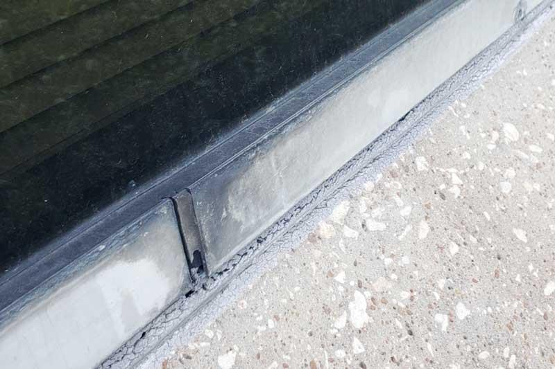 damaged caulking around window dallas texas office building