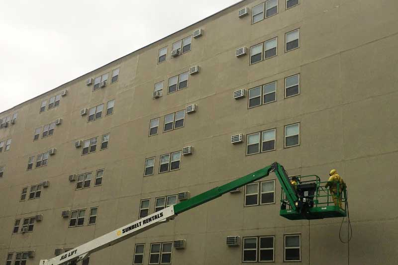 Apartment building undergoing waterproofing services New York