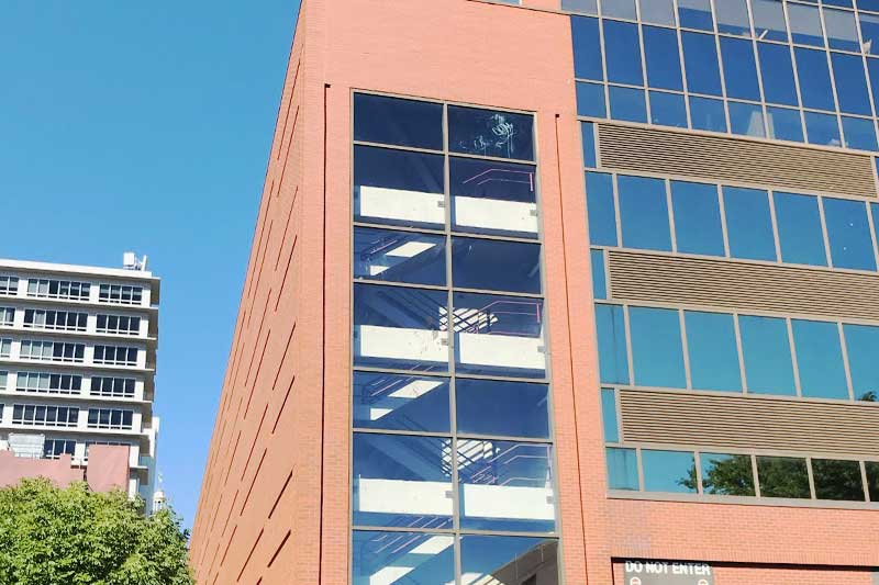 Caulking glass to brick joints, brick to metal joints, and wet glazing windows is part of commercial building waterproofing services