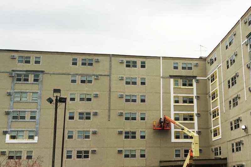 Commercial building restoration contractors installing EIFS